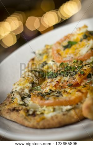 Personal size flatbread authentic margherita pizza with fresh tomatoes