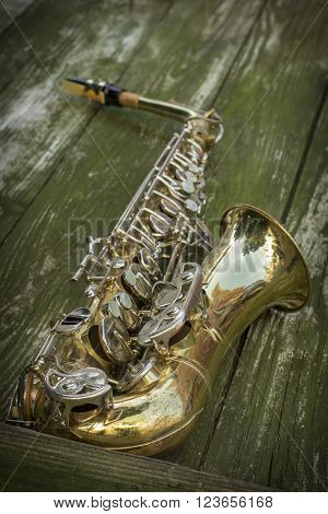 Jazz musical instrument saxophone with grungy street background