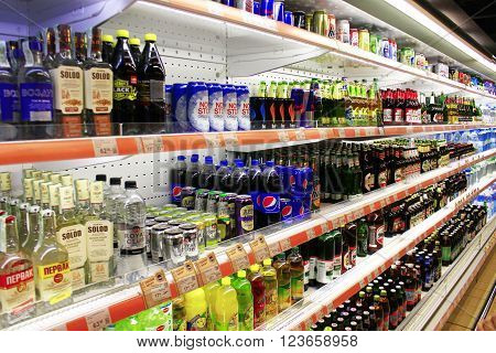Chernihiv / Ukraine. 06 March 2016:different kinds of beer and soft drinks like cola with wide assortment on the shelves of supermarket. 06 March 2016 in Chernihiv / Ukraine.