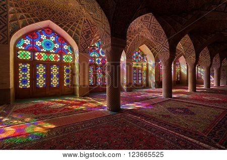 SHIRAZ, IRAN - SEPTEMBER 18, 2014: Interior of ornamental Nasir Al-Molk Mosque with colorful stained glass windows. It is also called Pink Mosque and was built from 1876 to 1888 during Qajar rule.