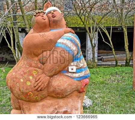 The sculpture of a young corpulent couple in dance. KIKINDA - February 03; TERRA CERAMICA GALERIA OUTDOORS; SCULPTURE