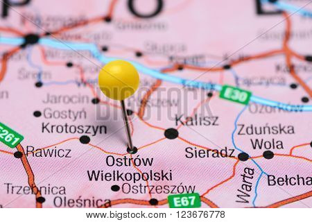 Photo of pinned Ostrow Wielkopolski on a map of Poland. May be used as illustration for traveling theme.