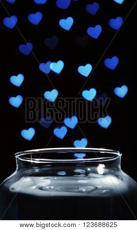 Love magic bottle on black background