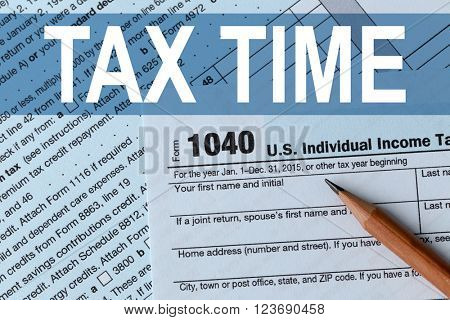 Tax Concept. 1040 Individual Income Tax Return Form for 2015 year with a pencil to fill in, close up