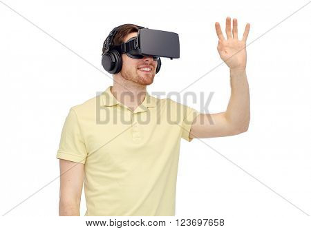 3d technology, virtual reality, entertainment and people concept - happy young man with virtual reality headset or 3d glasses playing game