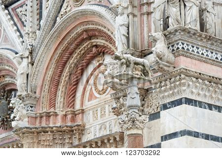 sculpture of Capitoline wolf (Romulus and Remus) at Duomo of Siena in Tuscany, Italy.