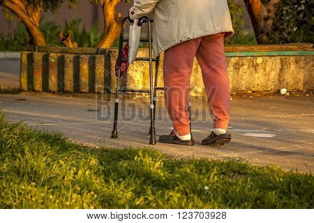 Senior woman using a walker concept of dissable person