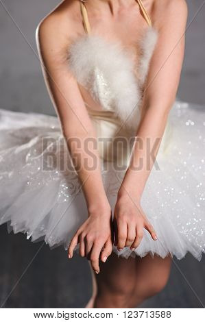 hands ballerina on a background of white tutu. Graceful movements of hand. ballerina hands touched to the ballet skirt dress.