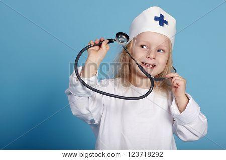 little funny girl playing nurse studio photo
