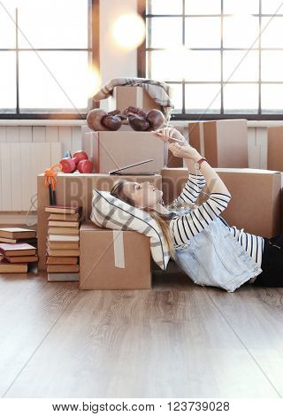 Cute girl during moving home