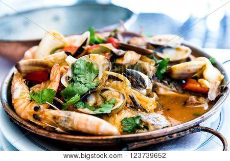 closeup mix seafood soup pot.