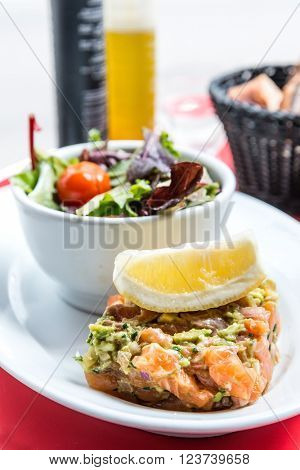 salmon and lemon - french cuisine dish with tomato and salmon