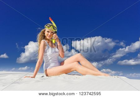 Young girl with diving mask on the beach
