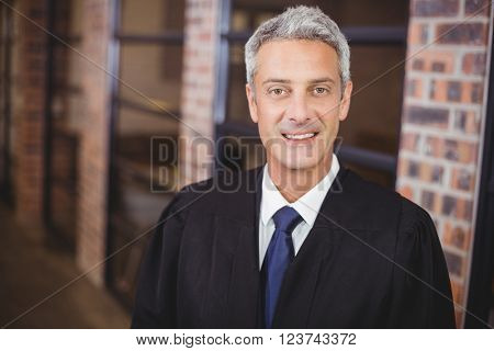 Close-up portrait of happy male lawyer in office