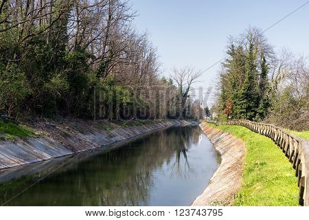 Lane for bicycles and pedestrians along the Canal Villoresi in Brianza (Monza Lombardy Italy) at early spring