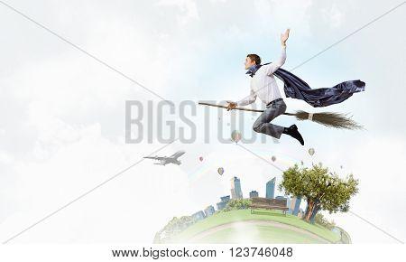 Man riding besom