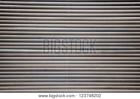 Morning sun shing through closed wooden blinds