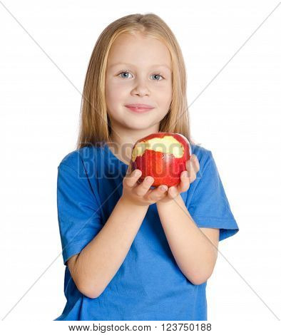 Beautiful Girl At Table Shows The Bitten Apple On White Background