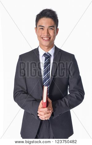 handsome businessman with book isolated