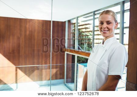 Portrait of smiling masseuse at spa
