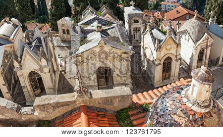 MENTON, FRANCE - MARCH 12, 2016: Old tombs and graves of Menton families and foreign aristocrats on local cemetery - first built in 1808, located on site of medieval castle which no longer exists.