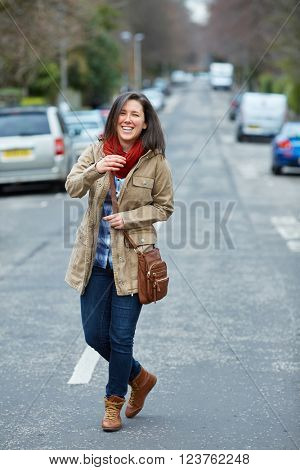 Young student female walk on the street, urban shoot