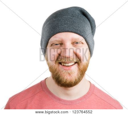 Funny bearded man in a knitted cap