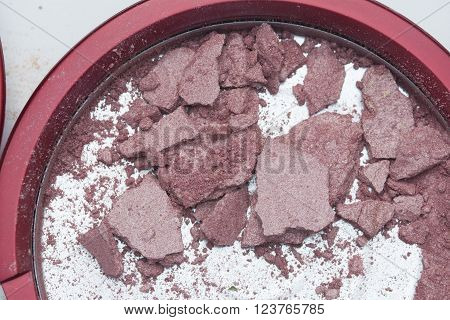 top view natural red cheek blusher crack on white background