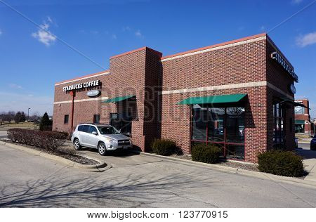 BOLINGBROOK, ILLINOIS / UNITED STATES - MARCH 4, 2016: The Starbucks Coffee Shop offers a drive-through service for customers who do not wish to enter the store in Bolingbrook.