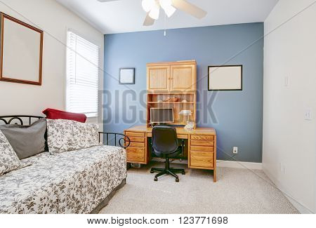 Home office or guest bedroom with desk and computer