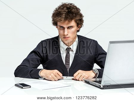 Modern businessman at the workplace working with computer depression and crisis concept