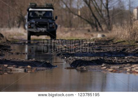 All terrain vehicle about to cross a puddle of mud.