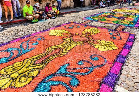 Antigua Guatemala - March 24 2016: Locals admire handmade dyed sawdust Holy Thursday carpets for procession in colonial town with most famous Holy Week celebrations in Latin America.