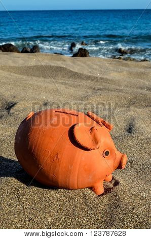 Closeup of Piggy Bank on the Sand Beach