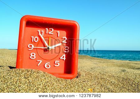Closeup of a Clock on the Sand Beach