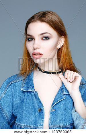 Young beautiful woman wearing denim jacket. Beauty Fashion Model Woman face.