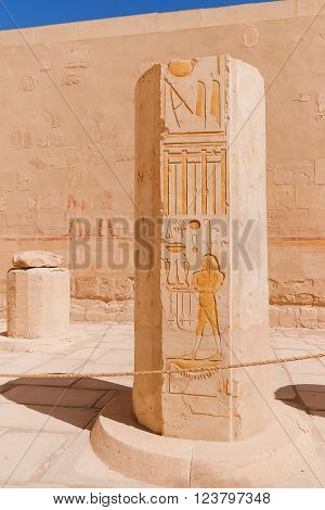 Mortuary temple of Hatshepsut in Deir el-Bahari. Ancient wall with the engraved Egyptian hieroglyphs. Deir el-Bahari Egypt.