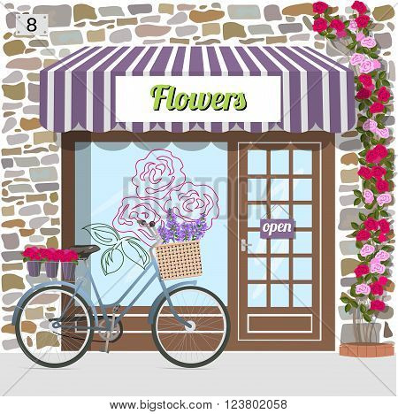 Flower shop's building facade of stone. Bicycle with flowers in a basket. Rose sticker on the window. Climbing rose near the door. Vector illustration eps 10.
