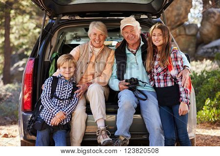 Grandparents and grandkids at the back of car before hiking