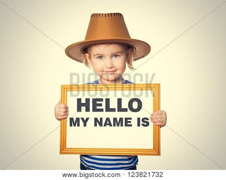 Little Funny girl in striped shirt with blackboard. Text HELLO MY NAME IS.  Isolated on gray background.