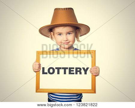 Little Funny girl in striped shirt with blackboard. Text LOTTERY.  Isolated on gray background.