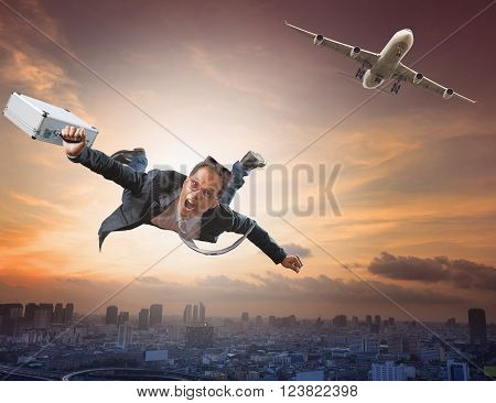 crazy business man flying from passenger plane with glad and happiness emotion use for new trend people traveling and top secret strategy