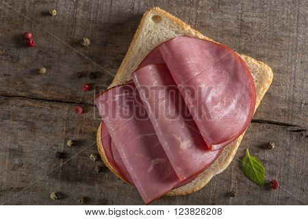 Beef sandwich. Pastrami beef thinly sliced on fresh whole grain bread