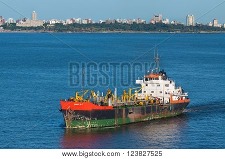 Montevideo Uruguay - December 15 2012: Trailing Suction Hopper Dredger Draga D-7 in the Port of Montevideo Uruguay. Montevideo has a natural port with the enough dredging to allow cargo ships dock comfortably.
