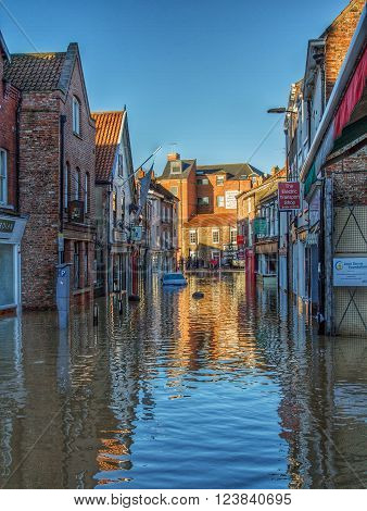 YORK, UK - CIRCA JANUARY, 2016. The flooded streets of York, UK after prolonged heavy rainfall caused the River Ouse to burst its banks.