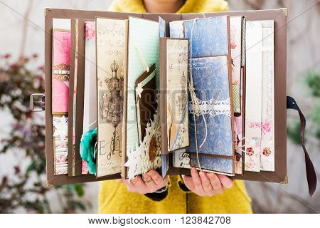 Scrapbook that was handmade, beautiful craft book arranged with different materials and papers, ideal for gift.