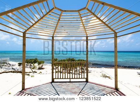 The framed view of a beach on Grand Turk island (Turks and Caicos).