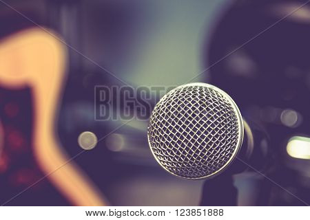 selective focus microphone and blur electric guitar background.