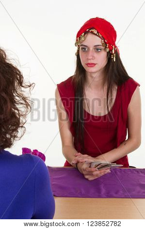 Brunette Woman Fortuneteller With Tarot Cards Isolated On White