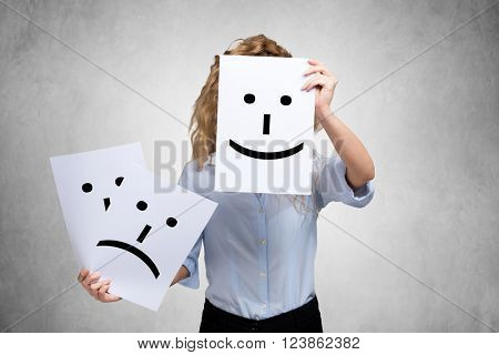 Conceptual image of a woman changing her mood from bad to good